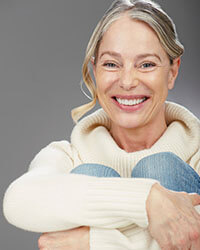 image of a smiling lady in her 50s